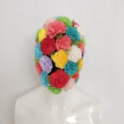 Colorful flower headwear artist